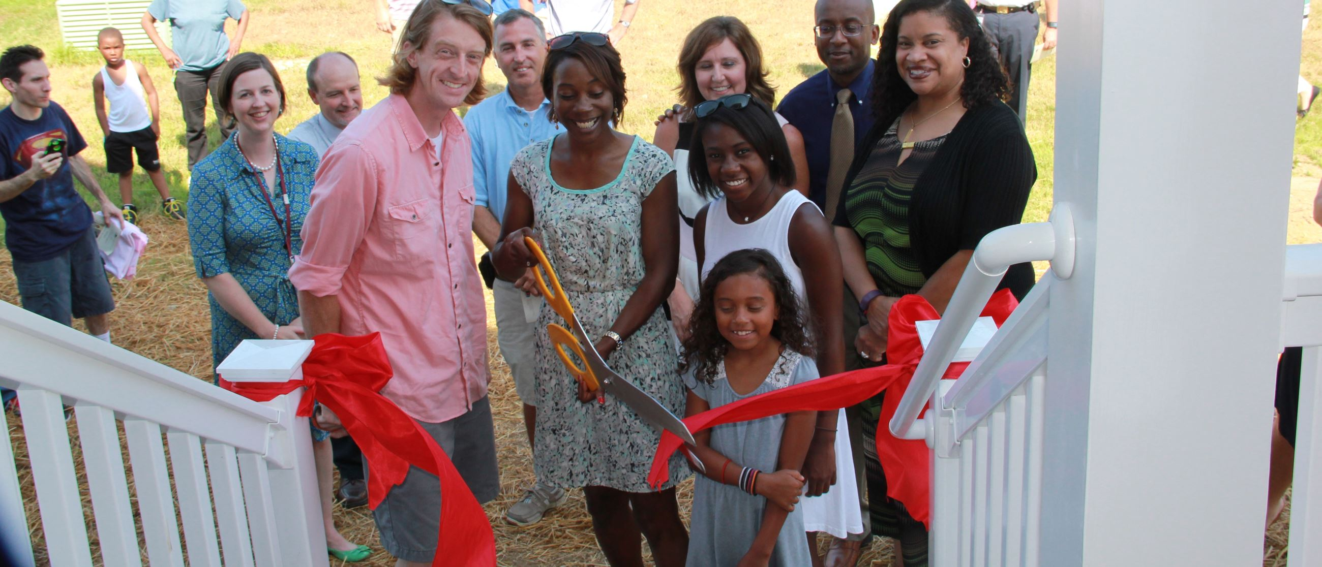 New homeowner family cuts the ribbon to their new home